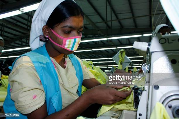 woman worker in garment industry - bangladesh stock photos and pictures