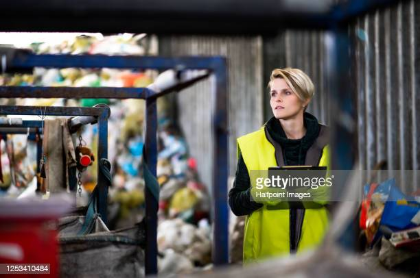 woman worker on landfill, waste management and environmental concept. - 埋め立てごみ処理地 ストックフォトと画像