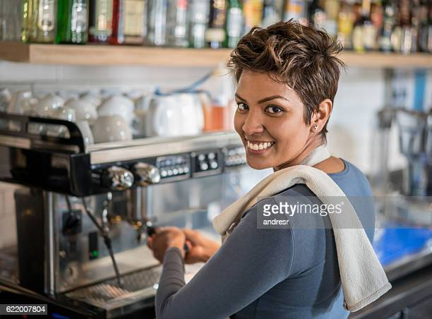 Woman working as barista at a cafe