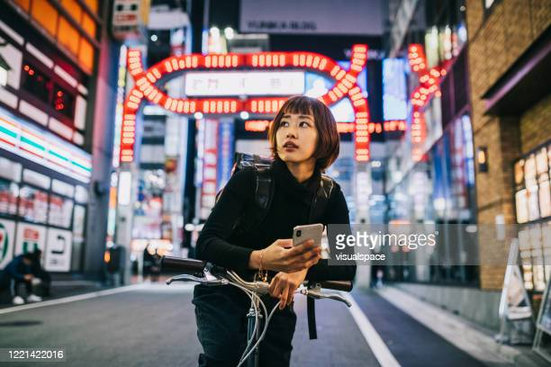 woman working as bike courier - japan stock pictures, royalty-free photos & images