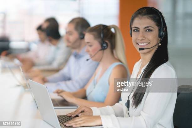 Woman working at a call center and looking very happy