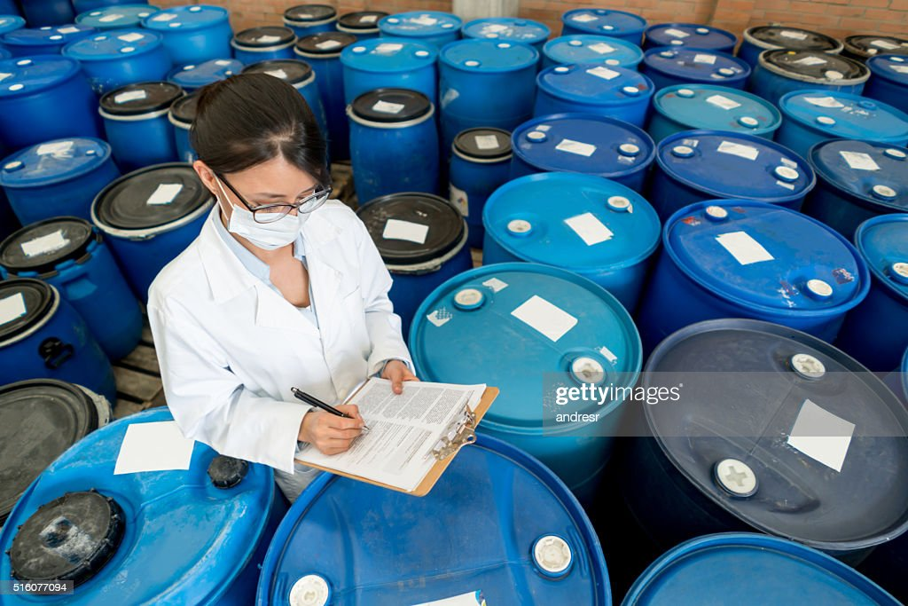 Woman working at a chemical plant : Stock Photo
