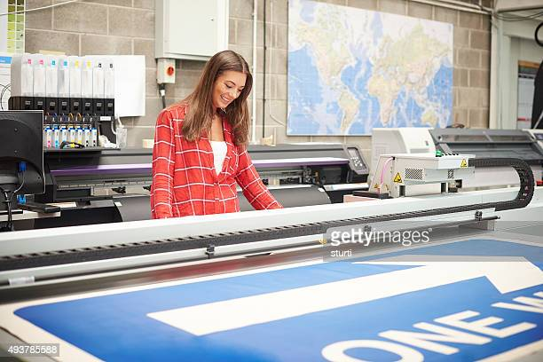 woman working at a digital printers