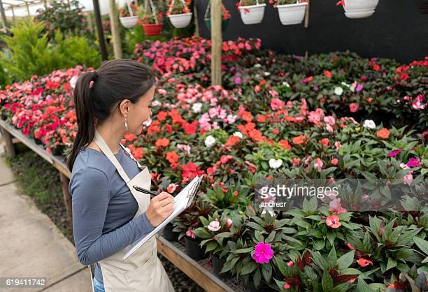 Woman working at a garden center