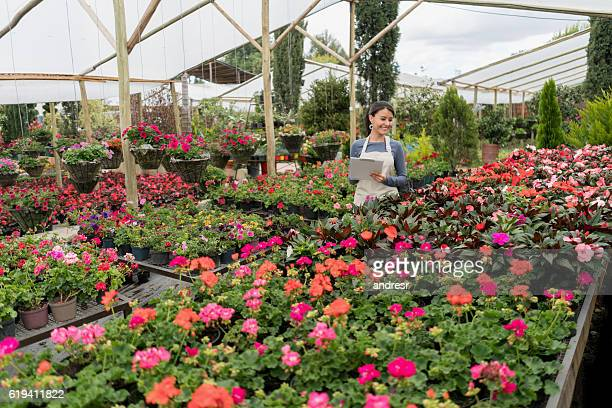 Woman working at a greenhouse