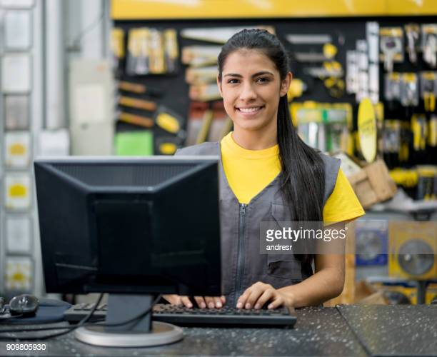woman working at a hardware store - checkers stock photos and pictures