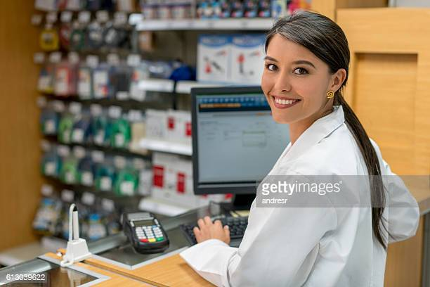 woman working at a pharmacy - assistant stock pictures, royalty-free photos & images