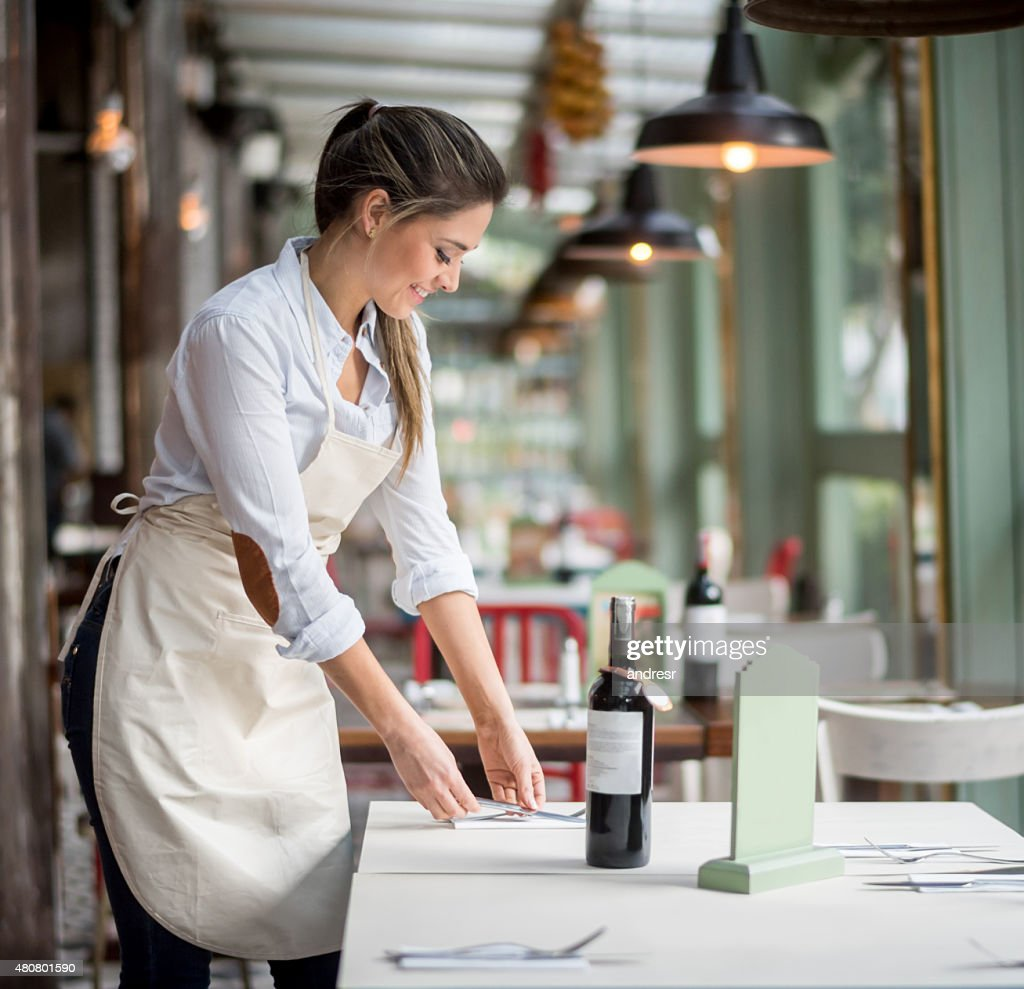 Woman Working At A Restaurant As A Waitress High-Res Stock ...