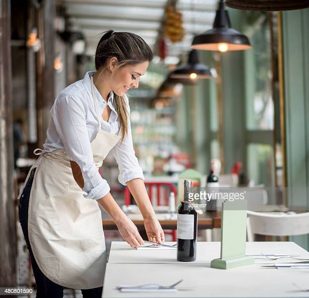 Woman working at a restaurant as a waitress