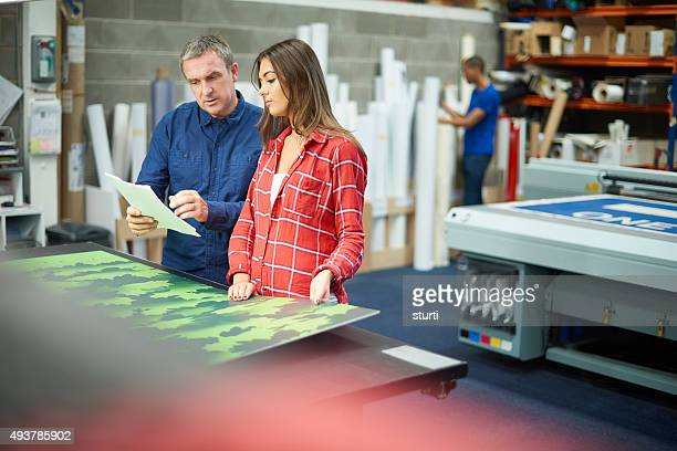 woman working at a signage company - printout stock pictures, royalty-free photos & images
