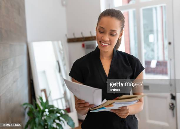 woman working at a spa checking the mail - mail stock pictures, royalty-free photos & images