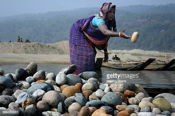 A woman working at a stone quarry on the bank of Dauki River Jaflong Sylhet Bangladesh January 19 2010