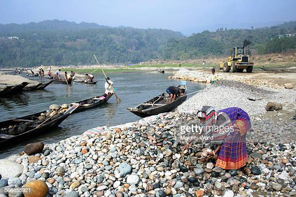 A woman working at a stone quarry on the bank of Dauki River Jaflong Sylhet Bangladesh January 19 2010