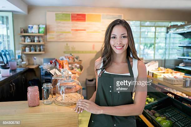 Woman working at an organic food market