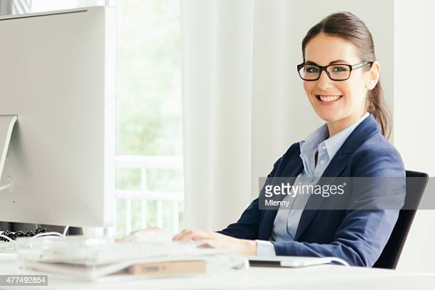 Woman working at computer in modern office