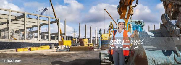 woman working at construction site against sky - val thoermer stock-fotos und bilder