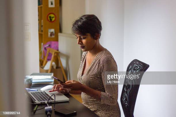Woman working at desk with computers