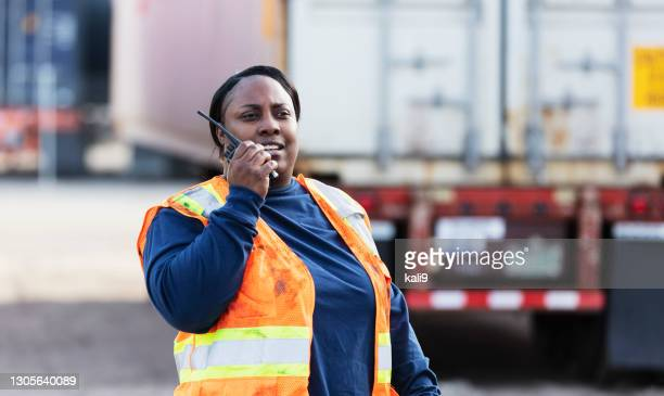 woman working at freight facility, on walkie talkie - radio stock pictures, royalty-free photos & images