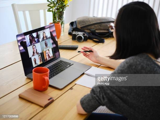 woman working at home on a web chat meeting - video conference stock pictures, royalty-free photos & images