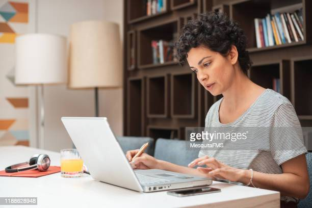 woman working at home on laptop - searching stock pictures, royalty-free photos & images
