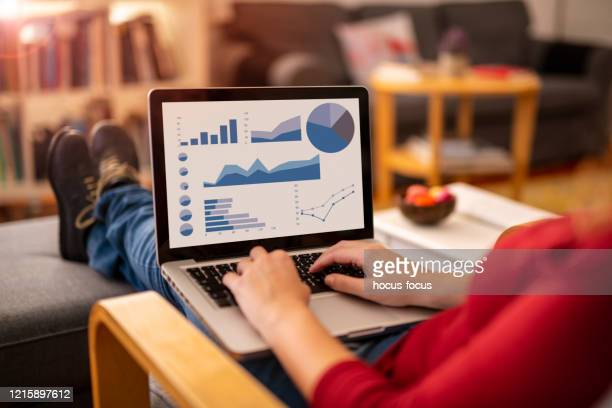 woman working at home - over the shoulder view stock pictures, royalty-free photos & images