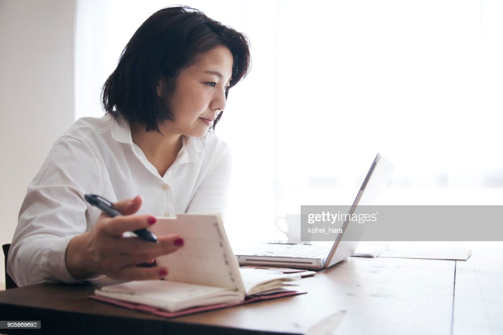 Woman working at home : Stock Photo