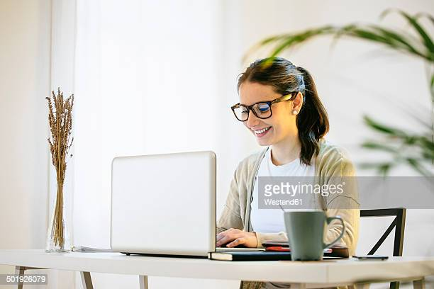 Woman working at modern home office