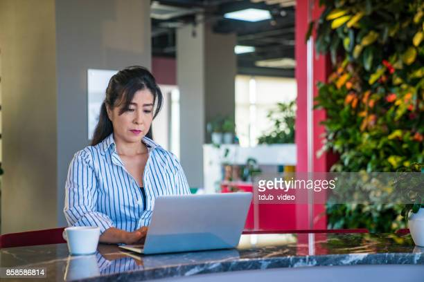 A woman working at office
