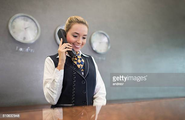 Woman working at the front desk of a hotel