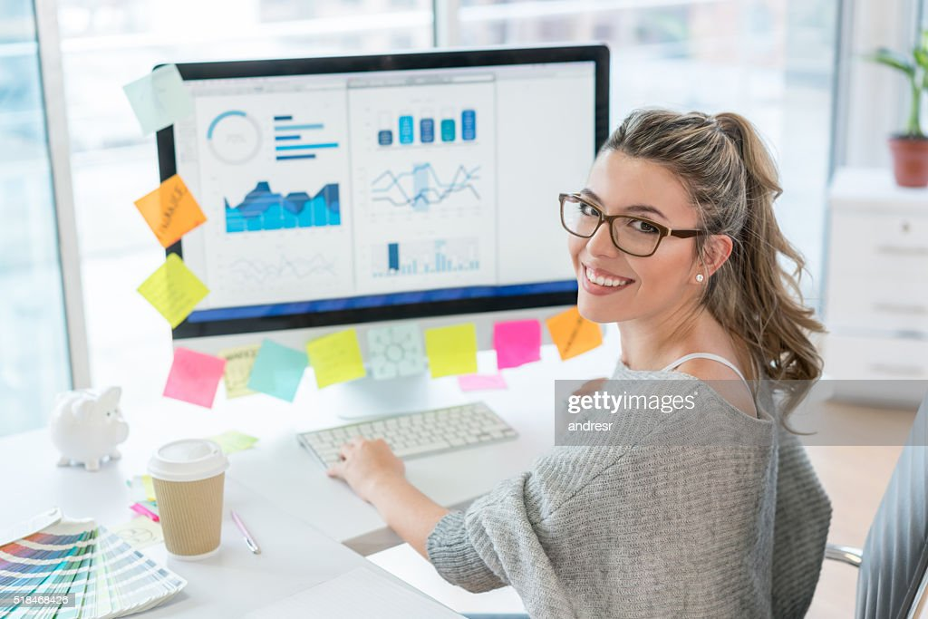 Woman working at the office : Stock Photo