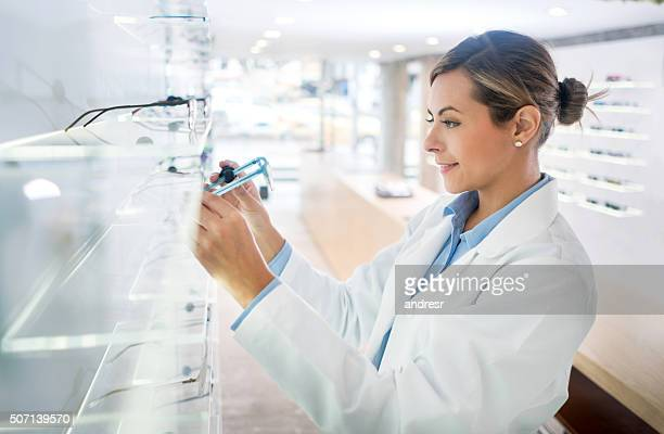 Woman working at the optician's shop