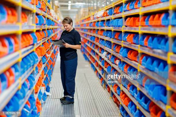 woman working at warehouse - images stock pictures, royalty-free photos & images