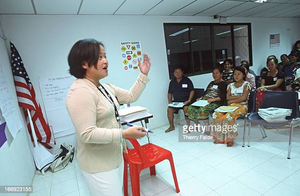 A woman working for the International Organization for Migration gives a cultural orientation session to Hmong refugees waiting to go to USA They...