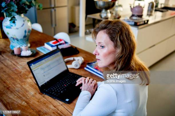 Woman working from home as a preventive measures against the spread of covid 19 disease.