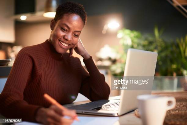 woman working from home, handwriting a document. - instructor stock pictures, royalty-free photos & images