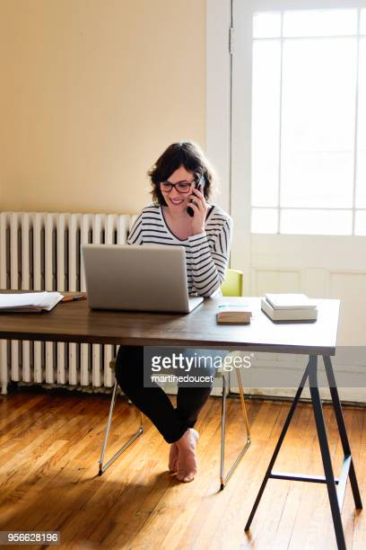 Woman working from home in her appartement.