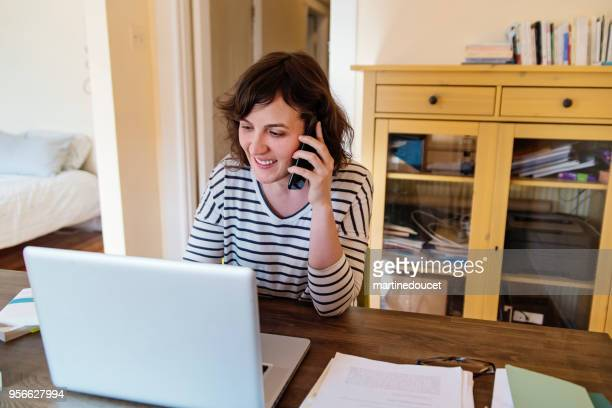 Woman working from home in her bedroom.
