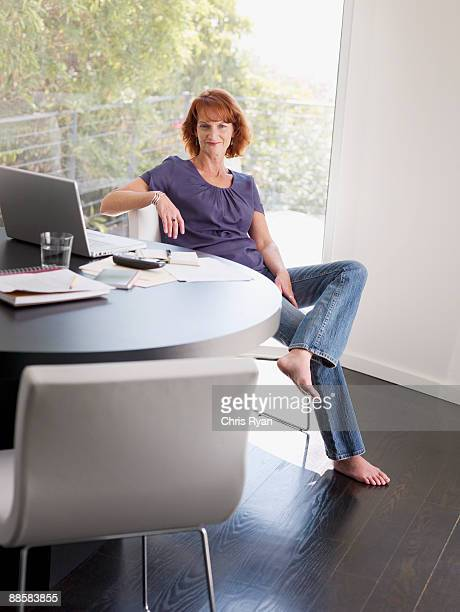 woman working from home - barefoot redhead stock photos and pictures