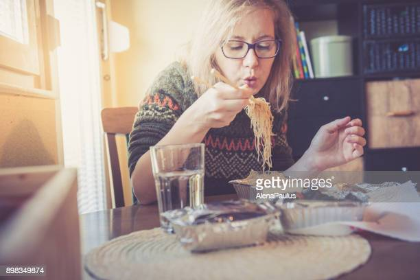 woman working from home - chinese takeout stock pictures, royalty-free photos & images
