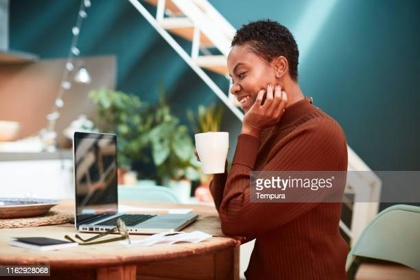 woman working from home, video conference with coworkers. - mid adult stock pictures, royalty-free photos & images