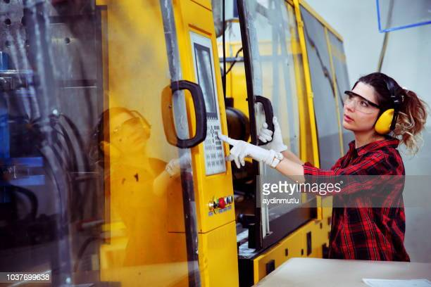 woman working in a factory - injecting stock pictures, royalty-free photos & images