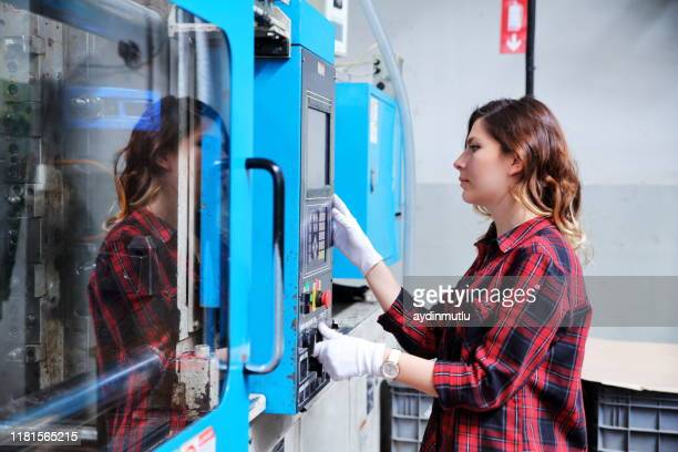 woman working in a factory - molding a shape stock pictures, royalty-free photos & images