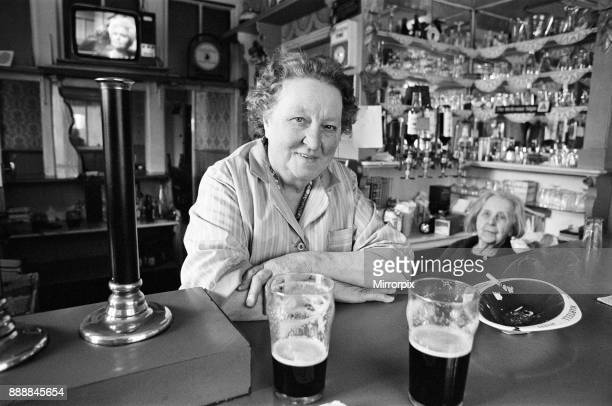 Woman working in a pub in Salford, Manchester, 16th July 1974.