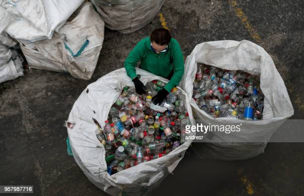 Woman working in a recycling center