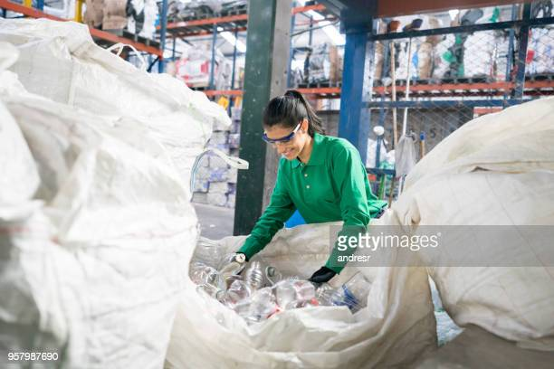 woman working in a recycling factory - recycling stock pictures, royalty-free photos & images