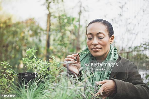 Woman working in a urban garden (London, UK)