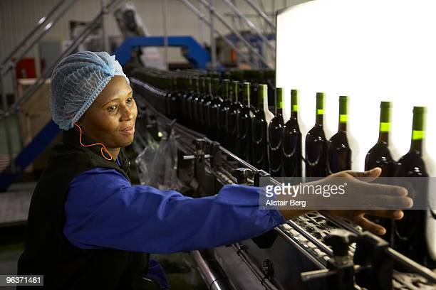 Woman working in a wine bottling factory