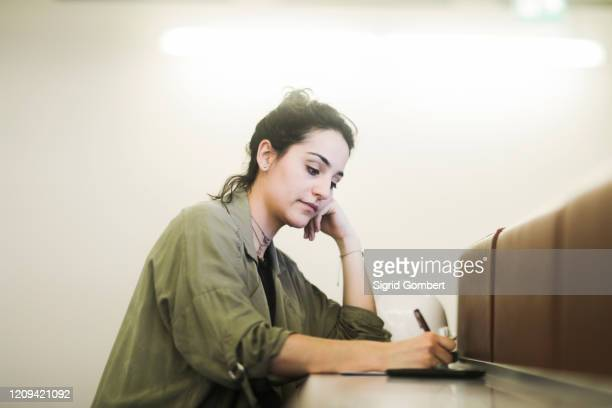 woman working in an office. - sigrid gombert stock pictures, royalty-free photos & images