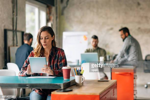 Woman working in an open space office
