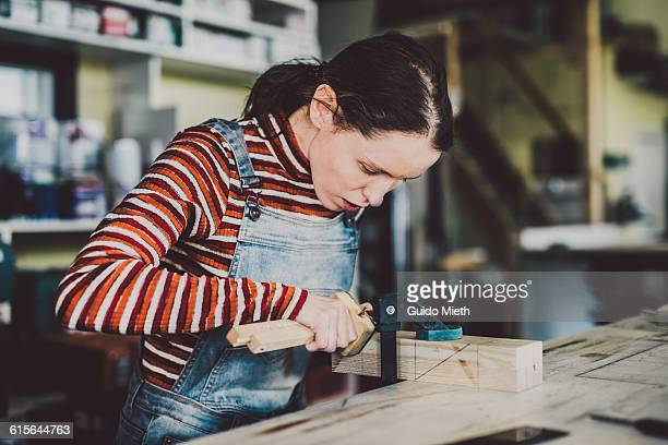 Woman working in carpentry.